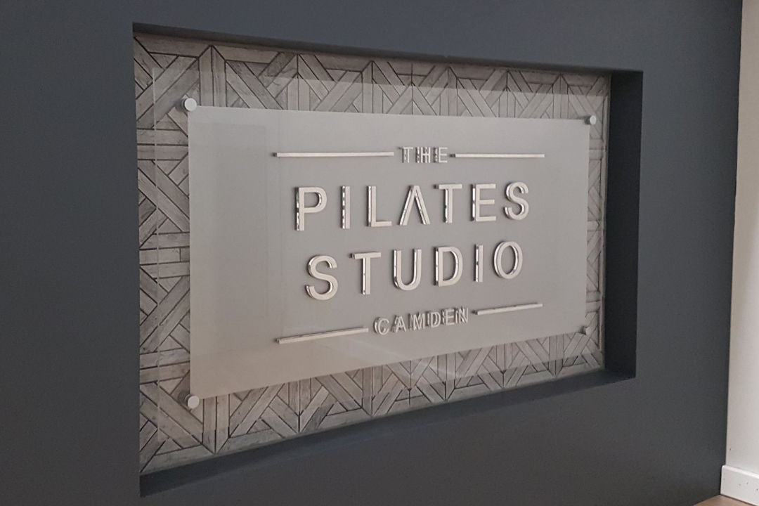 Fancy reception sign at The Pilates Studio in Camden.