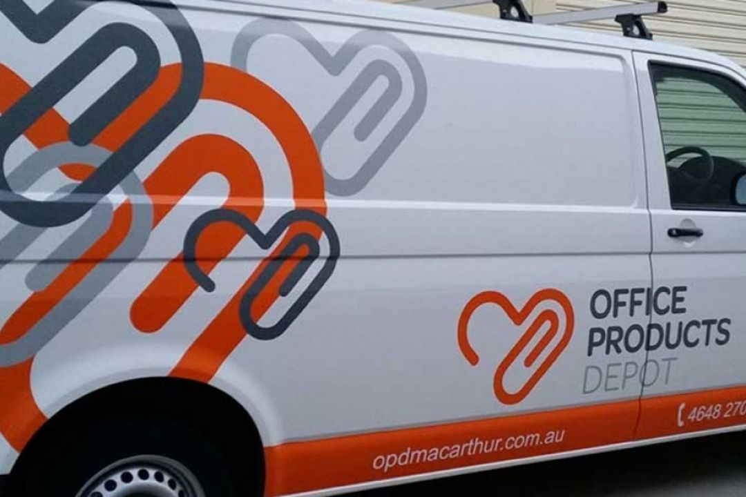Office products van with branded signage wrap.