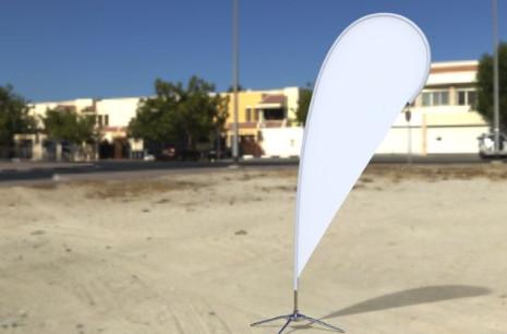Teardrop flag on beach