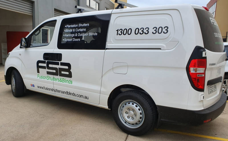 Simple van graphics with contact details.