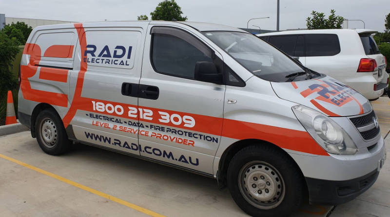 Company logo and branding on van.